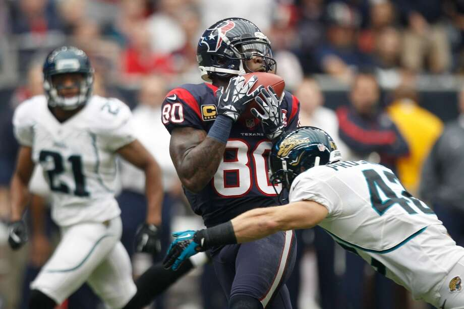 Texans wide receiver Andre Johnson (80) catches a 45-yard pass as Jaguars free safety Chris Prosinski (42) defends. (Brett Coomer / Houston Chronicle)