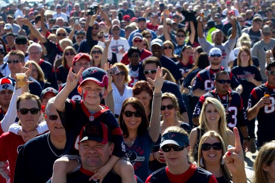 Texans fans walk toward Reliant Stadium before the game against the Jacksonville Jaguars.  (Brett Coomer / Houston Chronicle)