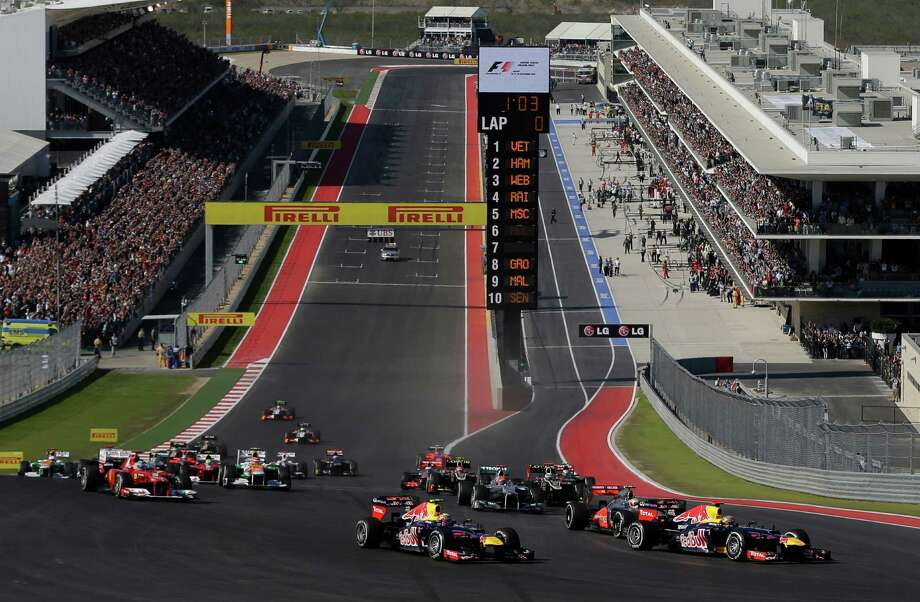 Sebastian Vettel leads the field into the first turn of the U.S. Grand Prix, which took place Sunday in Austin before 117,429. Photo: Eric Gay, STF / AP