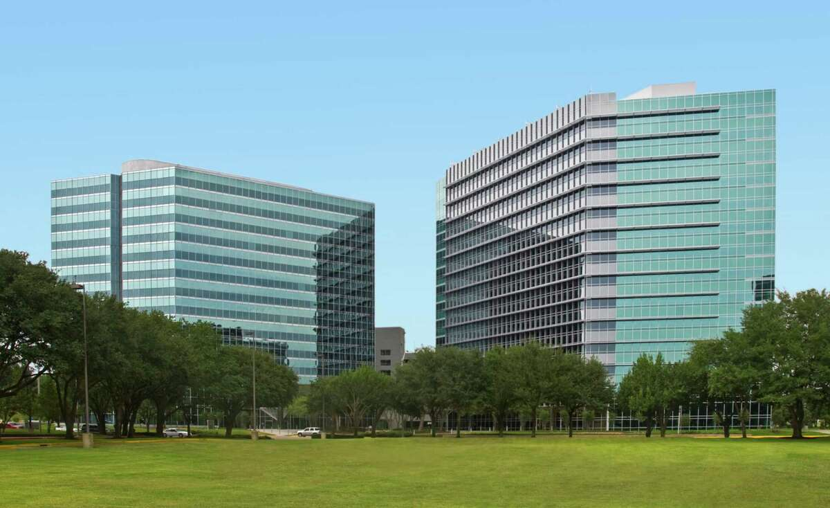 Granite Properties has sold Westchase I, left, and Westchase II, a sister building it developed, to Franklin Street Properties Corp.