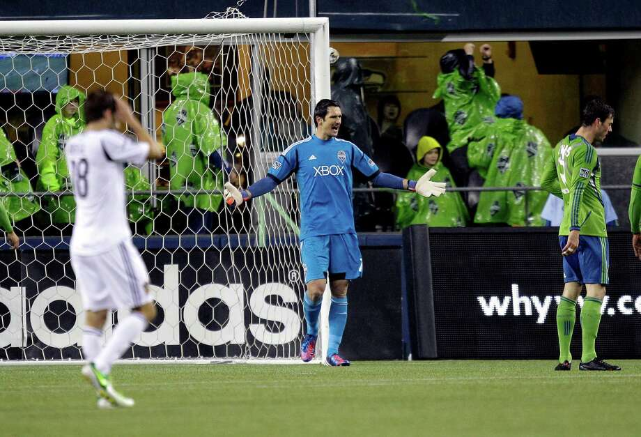 Seattle Sounders goalkeeper Michael Gspurning calls to his team after a play near the net against the Los Angeles Galaxy, in the first half of the MLS Western Conference championship soccer match, Sunday, in Seattle. (AP Photo/Ted S. Warren) Photo: Associated Press