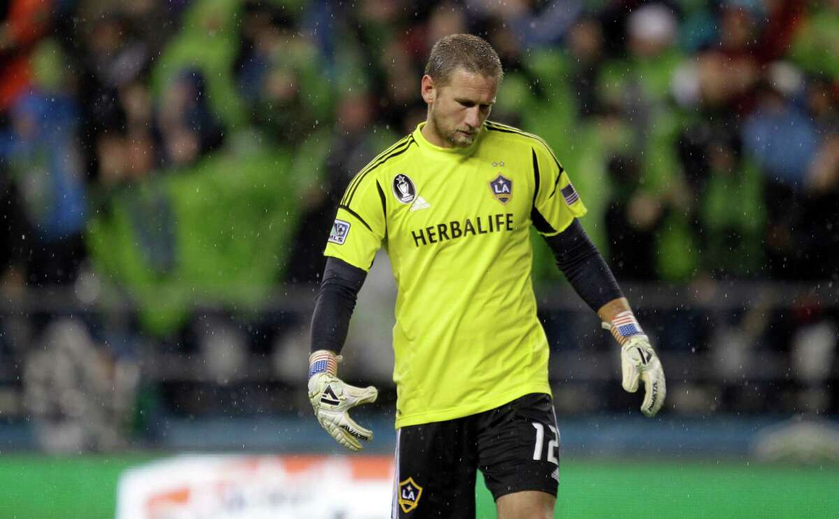Los Angeles Galaxy goalkeeper Josh Saunders reacts after Seattle Sounders' Eddie Johnson scored a goal during the first half of the MLS Western Conference championship soccer match, Sunday, in Seattle. (AP Photo/Ted S. Warren)