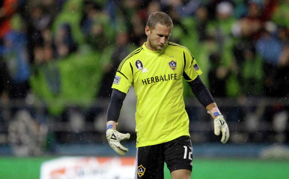 Los Angeles Galaxy goalkeeper Josh Saunders reacts after Seattle Sounders' Eddie Johnson scored a goal during the first half of the MLS Western Conference championship soccer match, Sunday, in Seattle. (AP Photo/Ted S. Warren) Photo: Associated Press