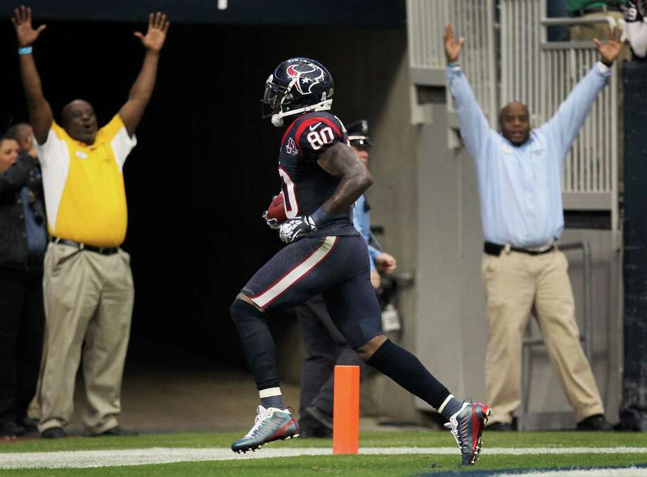 Texans wide receiver Andre Johnson (80) breaks away from the Jaguars defense for the game winning touch down. Photo: Nick De La Torre, Houston Chronicle / © 2012  Houston Chronicle
