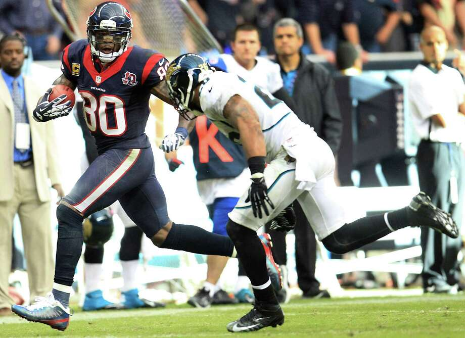 Texans wide receiver Andre Johnson (80) runs for the end zone as Jaguars strong safety Dawan Landry (26) tries to defend on the game winning touchdown during overtime. Photo: Karen Warren, Houston Chronicle / © 2012  Houston Chronicle