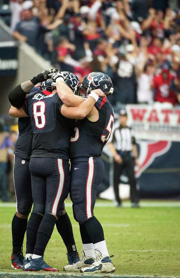Texans quarterback Matt Schaub (8) celebrates with center Chris Myers (55) and tackle Duane Brown (76) after throwing a touchdown to Andre Johnson for an overtime victory over the Jaguars. Photo: Smiley N. Pool, Houston Chronicle / © 2012  Houston Chronicle