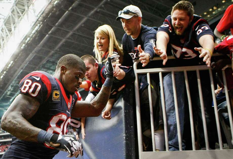 Texans wide receiver Andre Johnson gives fans high-fives after the Texans beat the Jacksonville Jaguars 43-37. Photo: Nick De La Torre, Houston Chronicle / © 2012  Houston Chronicle