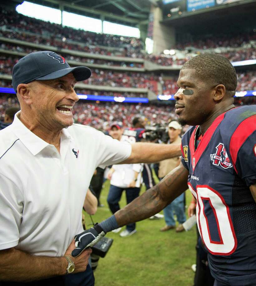 Texans wide receiver Andre Johnson celebrates with assistant head coach/defensive line Bill Kollar after the Texans 43-37 overtime victory. Kollar was hospitalized in Chicago to undergo tests for a blood clot that was discovered before the 13-6 victory over the Bears. Photo: Smiley N. Pool, Houston Chronicle / © 2012  Houston Chronicle