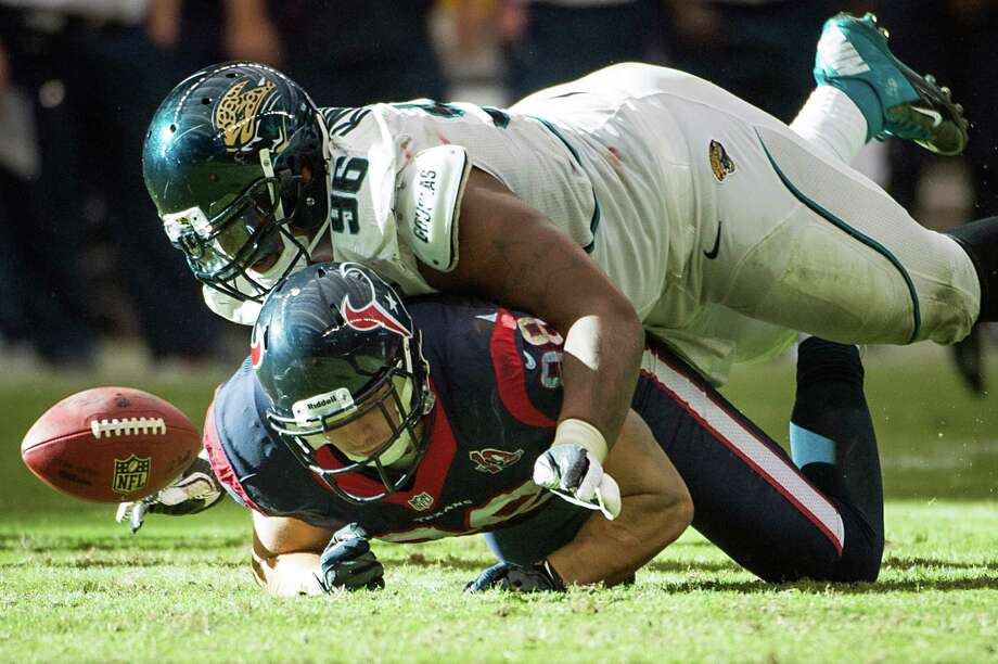 Jacksonville Jaguars defensive tackle Terrance Knighton (96) knocks a pass away from Houston Texans tight end Garrett Graham (88) during overtime. Photo: Smiley N. Pool, Houston Chronicle / © 2012  Houston Chronicle
