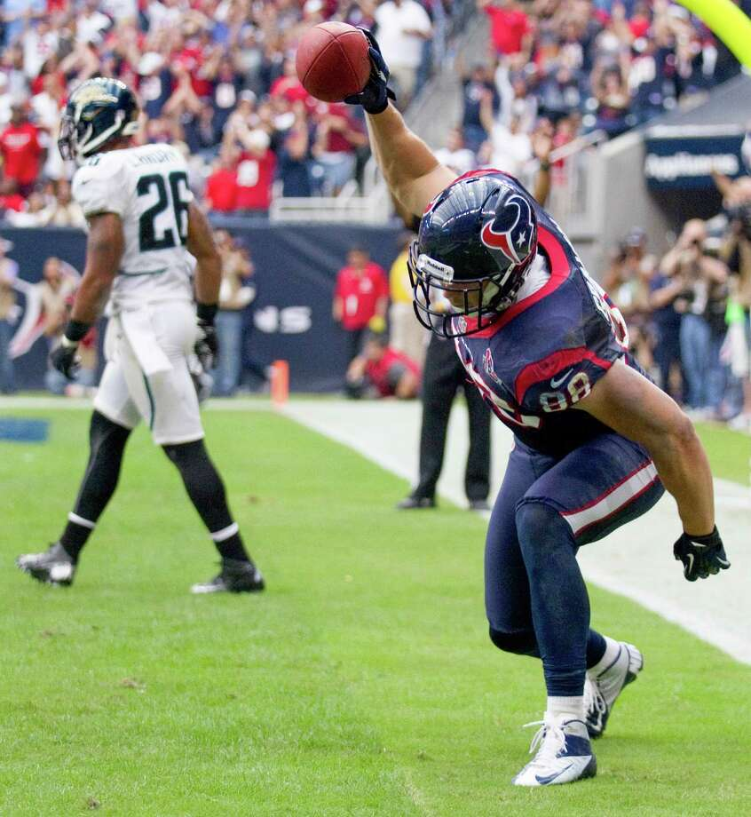 Texans tight end Garrett Graham (88) spikes the football after beating Jacksonville strong safety Dawan Landry (26) for a 5-yard touchdown reception to tie the game during the fourth quarter. Photo: Brett Coomer, Houston Chronicle / © 2012  Houston Chronicle
