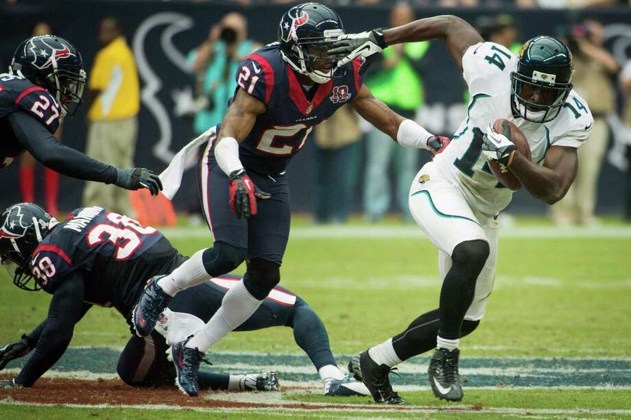 Jaguars wide receiver Justin Blackmon (14) breaks away from Houston Texans defensive backs Brice McCain (21), Danieal Manning (38) and Quintin Demps (27) on an 81-yard touchdown during the fourth quarter. Photo: Smiley N. Pool, Houston Chronicle / © 2012  Houston Chronicle
