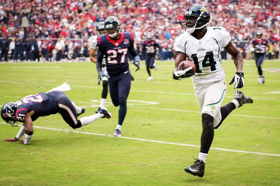 Jaguars wide receiver Justin Blackmon (14) races 81-yards past Texans defensive backs Quintin Demps (27) and Brice McCain (21. Photo: Smiley N. Pool, Houston Chronicle / © 2012  Houston Chronicle