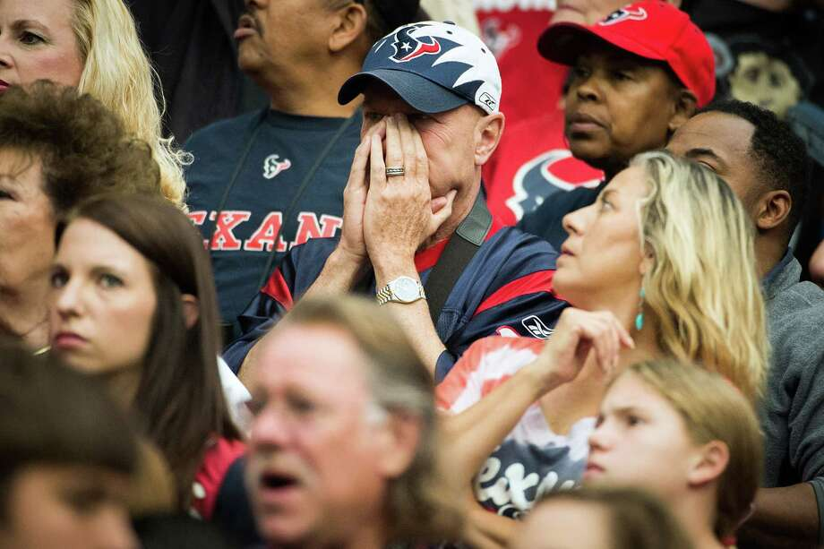 Texans fans experience some tense moments as the game heads to overtime tied 37-37. Photo: Smiley N. Pool, Houston Chronicle / © 2012  Houston Chronicle