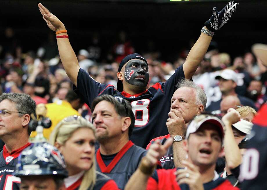 A Texans fan tries to quiet the crowd during the fourth quarter. Photo: Karen Warren, Houston Chronicle / © 2012  Houston Chronicle