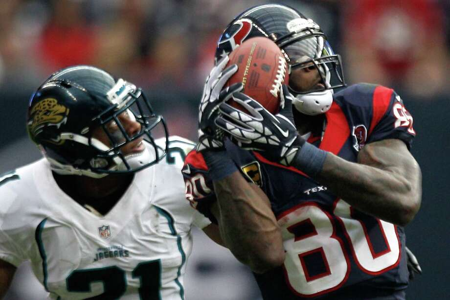 Texans wide receiver Andre Johnson (80) beats Jacksonville cornerback Derek Cox (21) for a reception during the fourth quarter. Photo: Brett Coomer, Houston Chronicle / © 2012  Houston Chronicle