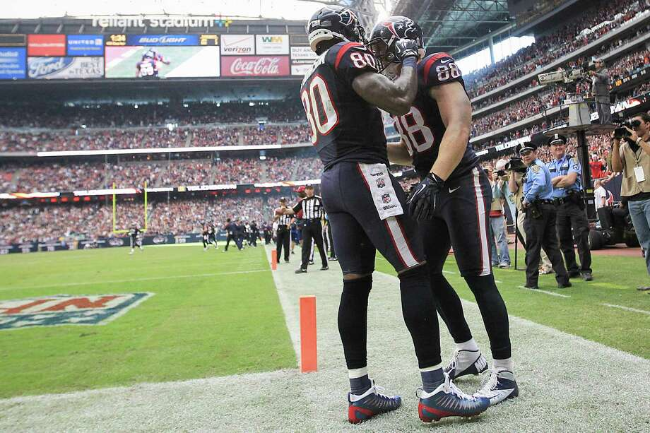 Texans tight end Garrett Graham (88) celebrates one of his touchdowns with wide receiver Andre Johnson (80) during the fourth quarter. Photo: Karen Warren, Houston Chronicle / © 2012  Houston Chronicle