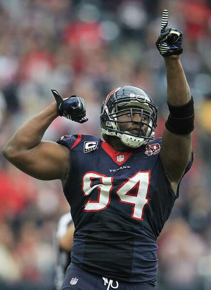 Texans defensive end Antonio Smith (94) reacts after stopping the Jacksonville Jaguars during the fo