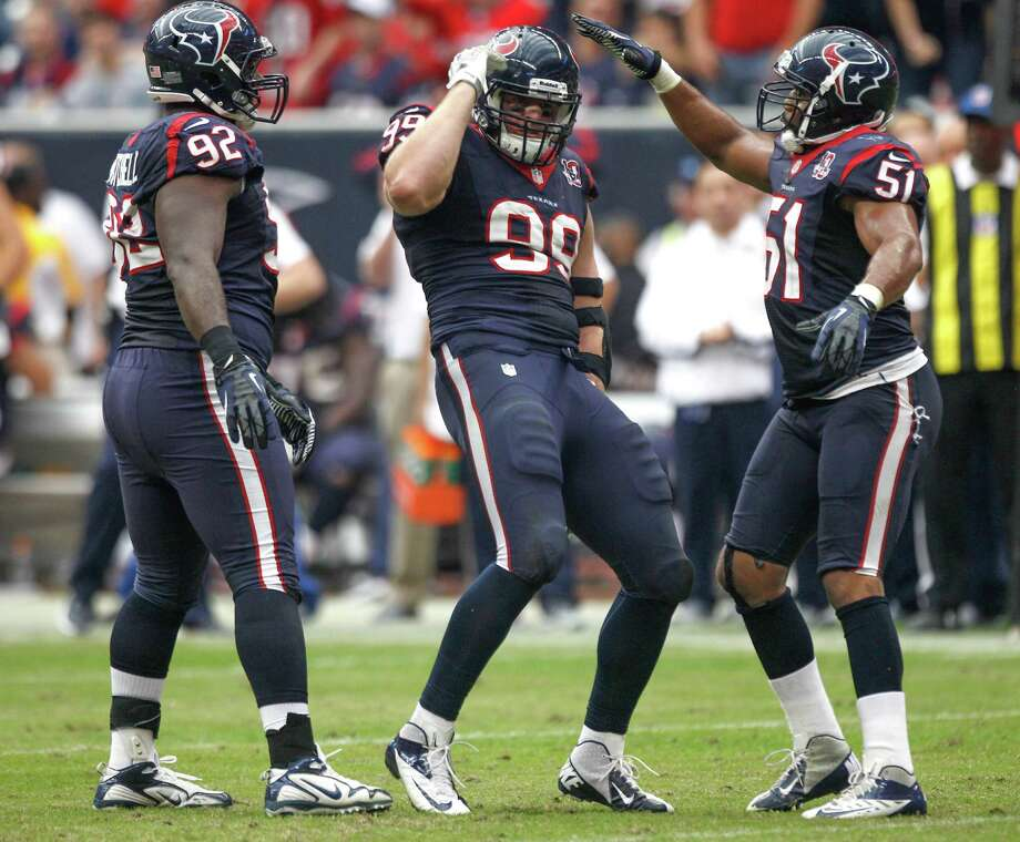 Texans defensive end J.J. Watt (99) celebrates his sack of Jacksonville quarterback Chad Henne with nose tackle Earl Mitchell (92) and linebacker Darryl Sharpton (51) during the fourth quarter. Photo: Brett Coomer, Houston Chronicle / © 2012  Houston Chronicle