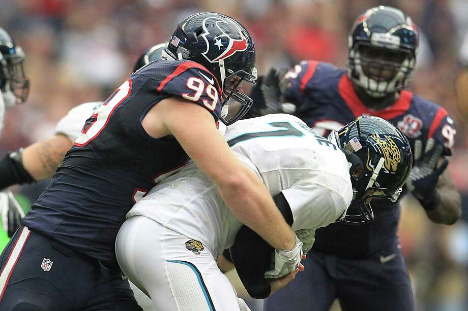 Texans defensive end J.J. Watt (99) sacks Jacksonville Jaguars quarterback Chad Henne (7) during the fourth quarter. Photo: Karen Warren, Houston Chronicle / © 2012  Houston Chronicle
