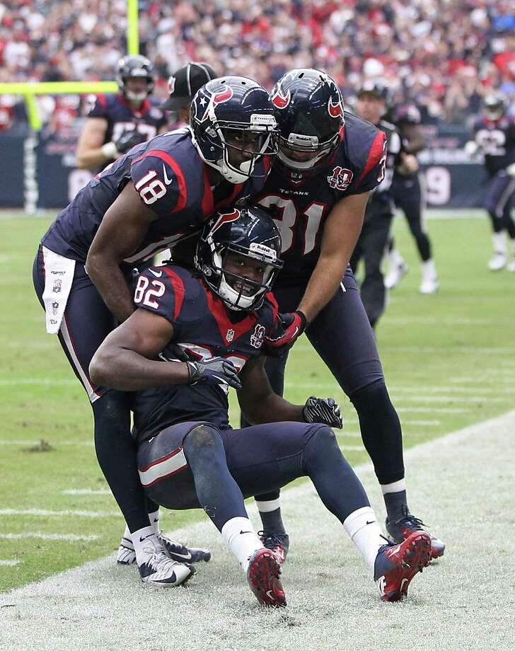 Texans wide receiver Keshawn Martin (82) gets help up from the turf after a long kickoff return. Photo: Karen Warren, Houston Chronicle / © 2012  Houston Chronicle