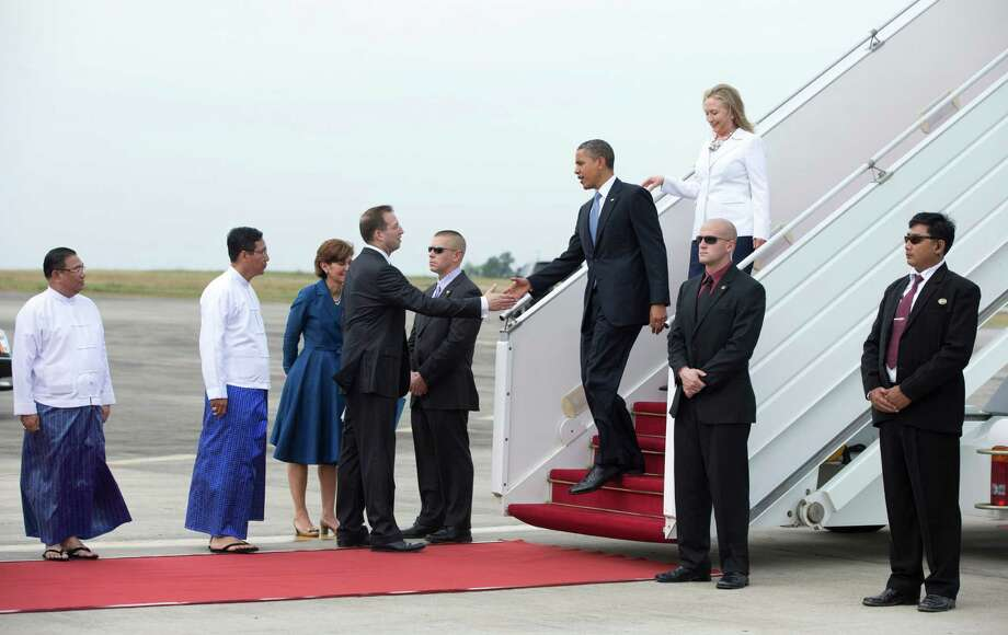 U.S. President Barack Obama and Secretary of State Hillary Rodham Clinton are greeted by U.S. Ambassador to Myanmar Derek Mitchell and dignitaries as they arrive at Yangon International Airport in Yangon, Myanmar, on Air Force One, Monday, Nov. 19, 2012. This is the first visit to Myanmar by a sitting U.S. president. Photo: Carolyn Kaster