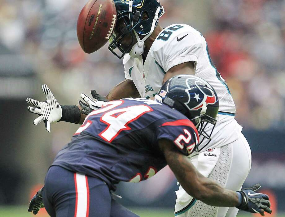 Texans cornerback Johnathan Joseph (24) breaks up a pass intended for Jaguars wide receiver Micheal Spurlock (86) during the third quarter. Photo: Karen Warren, Houston Chronicle / © 2012  Houston Chronicle