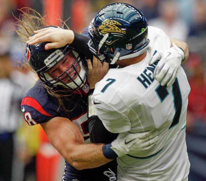 Texans outside linebacker Brooks Reed (58) hits Jacksonville quarterback Chad Henne (7) during the s