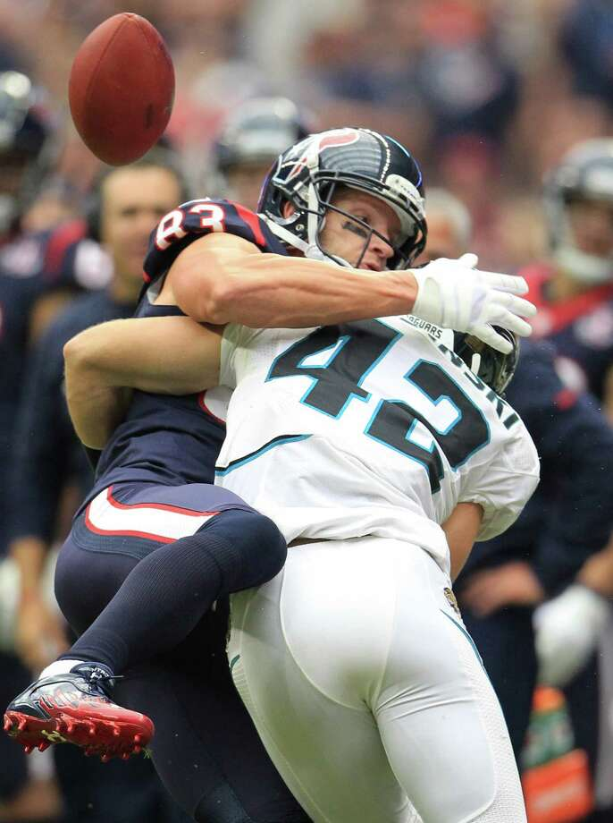 Jacksonville free safety Chris Prosinski (42) breaks up a pass intended for Texans wide receiver Kevin Walter (83) during the second quarter. Photo: Karen Warren, Houston Chronicle / © 2012  Houston Chronicle