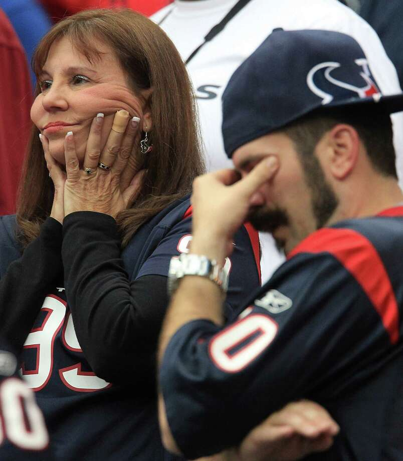 Texans fans react to a Jacksonville Jaguars interception during overtime. Photo: Karen Warren, Houston Chronicle / © 2012  Houston Chronicle