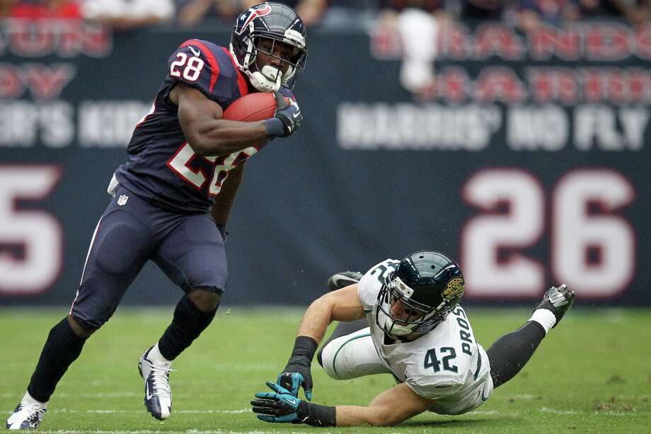 Texans running back Justin Forsett (28) gets past Jacksonville free safety Chris Prosinski (42) during the first quarter. Photo: Nick De La Torre, Houston Chronicle / © 2012  Houston Chronicle