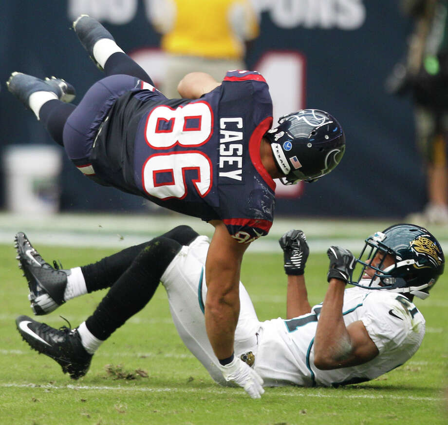 Texans fullback James Casey (86) is upended by Jacksonville cornerback Derek Cox (21) during the first quarter. Photo: Brett Coomer, Houston Chronicle / © 2012  Houston Chronicle