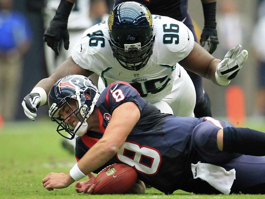 Texans quarterback Matt Schaub (8) recovers his own fumble as Jaguars defensive tackle Terrance Knighton (96) dives in after a hit by Jaguars defensive tackle C.J. Mosley during the first quarter. Photo: Karen Warren, Houston Chronicle / © 2012  Houston Chronicle