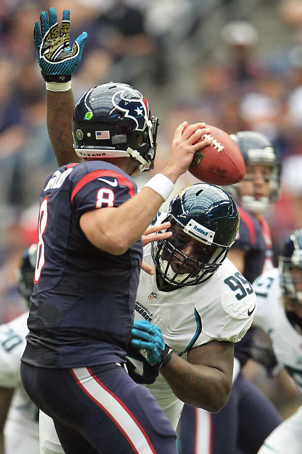 Jaguars defensive tackle C.J. Mosley (99) puts pressure on Houston Texans quarterback Matt Schaub (8) forcing a fumble that the Texans recovered during the first quarter. Photo: Karen Warren, Houston Chronicle / © 2012  Houston Chronicle