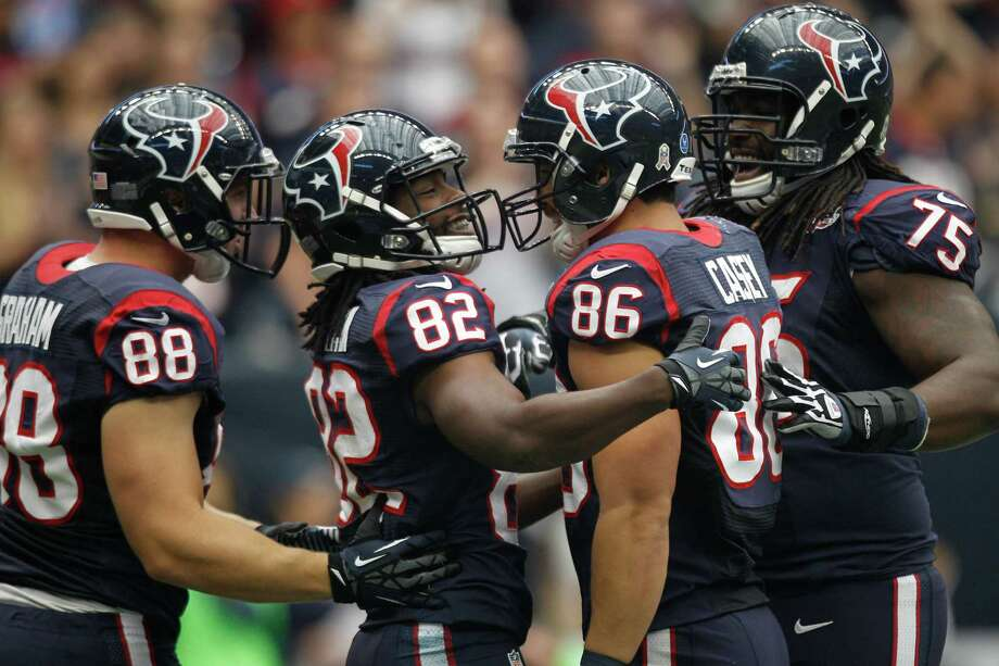 Texans wide receiver Keshawn Martin (82) celebrates with tight end Garrett Graham (88), fullback James Casey (86) after catching a 9-yard touchdown pass during the first quarter. Photo: Brett Coomer, Houston Chronicle / © 2012  Houston Chronicle