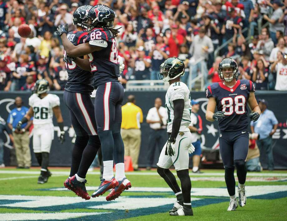 Texans wide receiver Keshawn Martin (82) celebrates with wide receiver Kevin Walter (83) during the first quarter after catching a touchdown pass. Photo: Smiley N. Pool, Houston Chronicle / © 2012  Houston Chronicle