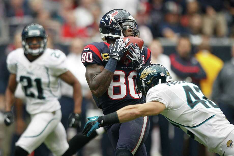 Texans wide receiver Andre Johnson (80) catches a 45-yard pass as Jaguars free safety Chris Prosinski (42) defends during the first quarter. Photo: Brett Coomer, Houston Chronicle / © 2012  Houston Chronicle