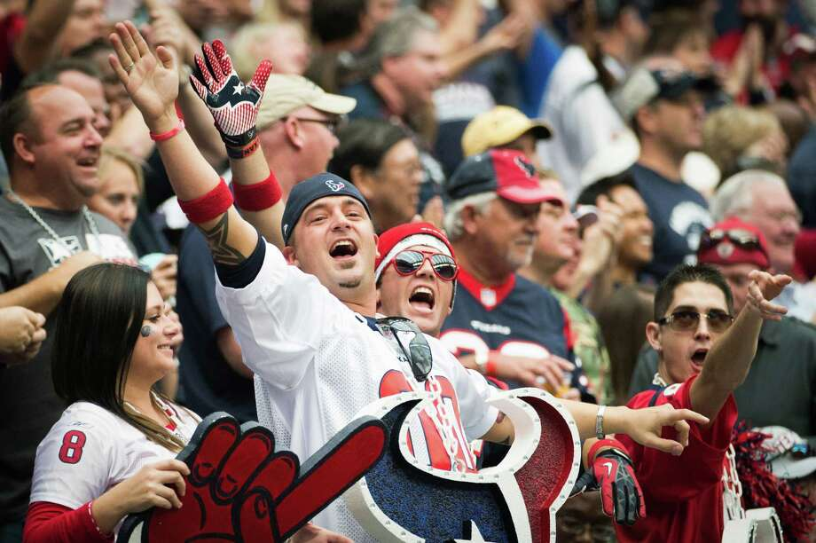 Texans fans cheer a first down against the Jaguars. Photo: Smiley N. Pool, Houston Chronicle / © 2012  Houston Chronicle