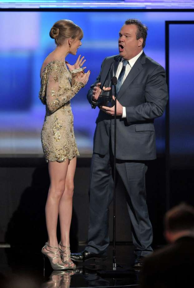 Taylor Swift accepts the award for Favorite Country Female Artist from presenter Eric Stonestreet at the 40th Annual American Music Awards on Sunday, Nov. 18, 2012, in Los Angeles. (Photo by John Shearer/Invision/AP) Photo: John Shearer, Associated Press / Invision