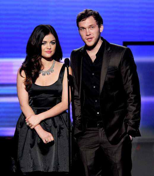 (L-R) Presenters Lucy Hale and Phillip Phillips speak onstage during the 40th American Music Awards