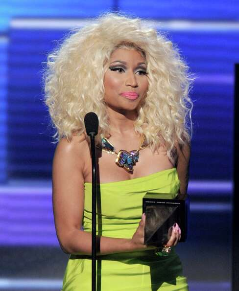 Rapper/singer  Nicki Minaj accepts the award for Favorite Rap/Hip-Hop Album onstage during the 40th