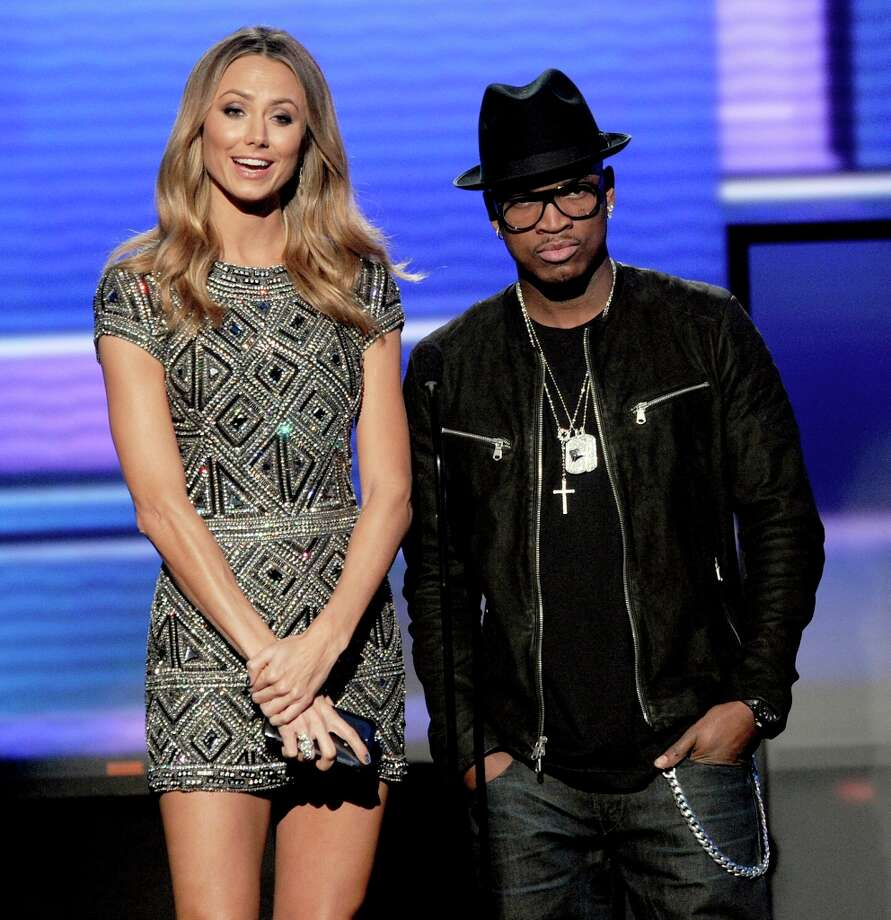 (L-R) Presenters Stacy Keibler and Ne-Yo speak onstage during the 40th American Music Awards held at Nokia Theatre L.A. Live on November 18, 2012 in Los Angeles, California.  (Photo by Kevin Winter/Getty Images) Photo: Kevin Winter, Getty Images / 2012 Getty Images