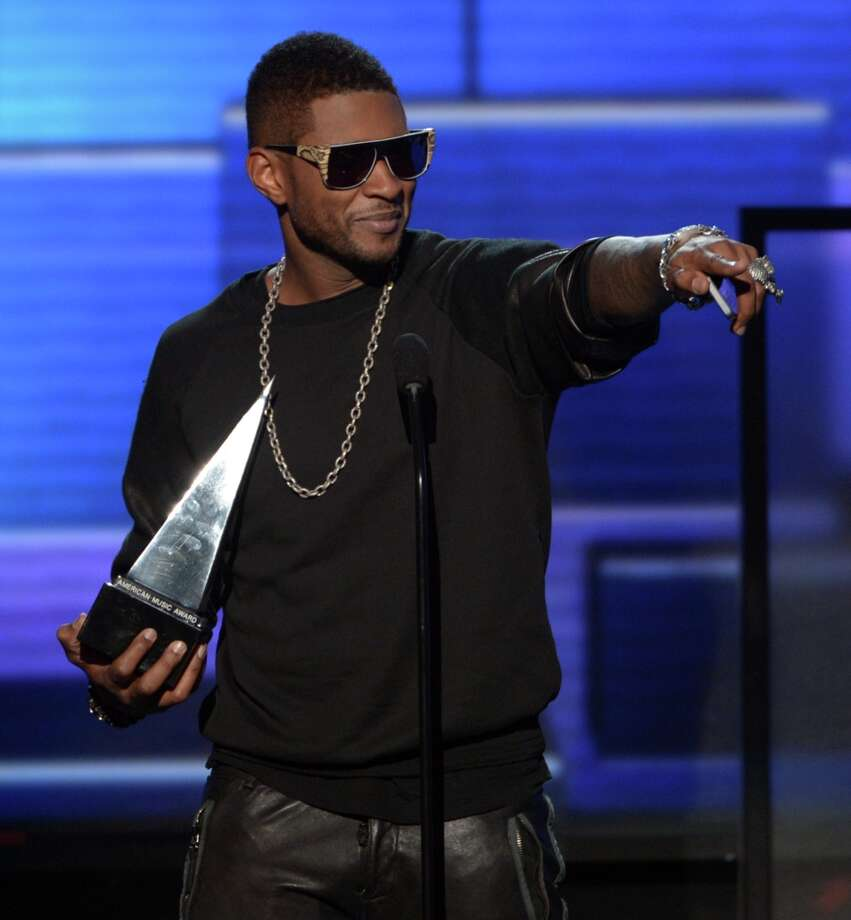Singer Usher accepts the award for Favorite Soul/R&B Male Artist onstage during the 40th American Music Awards held at Nokia Theatre L.A. Live on November 18, 2012 in Los Angeles, California.  (Photo by Kevin Winter/Getty Images) Photo: Kevin Winter, Getty Images / 2012 Getty Images