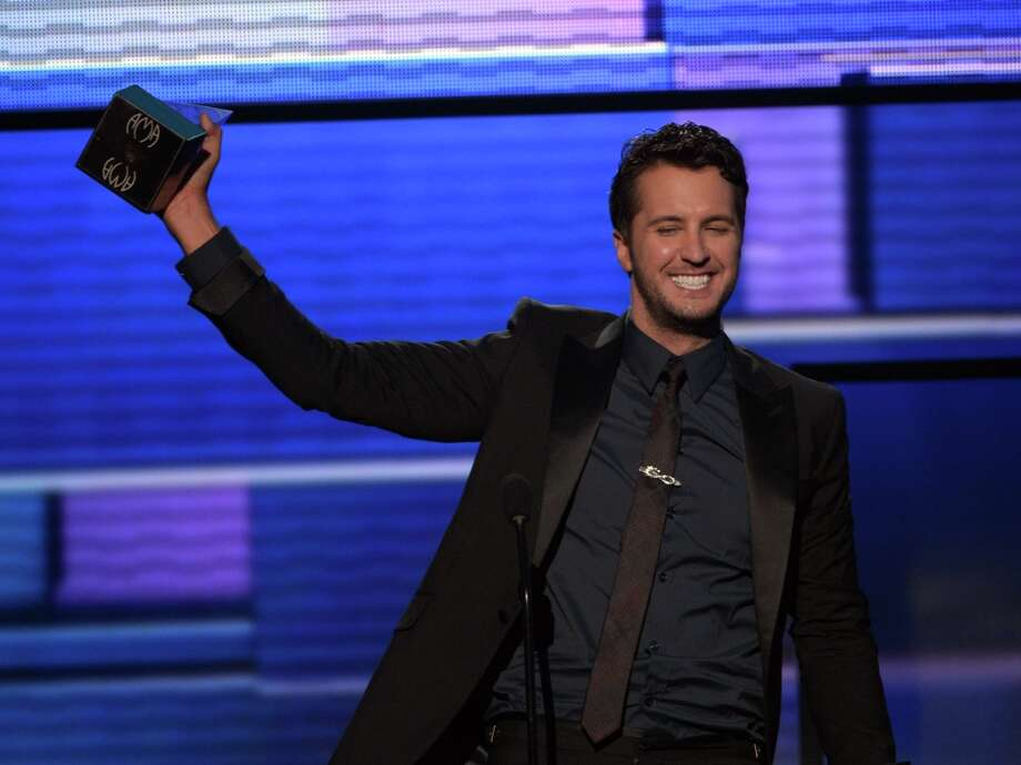 Singer Luke Bryan accepts the award for Favorite Country Male Artist onstage during the 40th American Music Awards held at Nokia Theatre L.A. Live on November 18, 2012 in Los Angeles, California.  (Photo by Kevin Winter/Getty Images) Photo: Kevin Winter, Getty Images / 2012 Getty Images