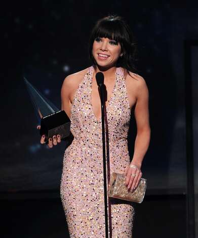 Singer Carly Rae Jepsen accepts the award for Old Navy New Artist of the Year onstage during the 40th American Music Awards held at Nokia Theatre L.A. Live on November 18, 2012 in Los Angeles, California.  (Photo by Kevin Winter/Getty Images) Photo: Kevin Winter, Getty Images / 2012 Getty Images