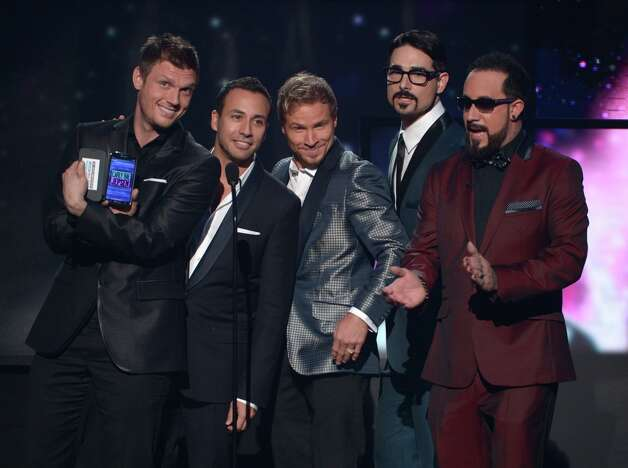 (L-R) Presenters Nick Carter, Howie Dorough, Brian Littrell, Kevin Richardson and AJ McLean of Backstreet Boys speak onstage during the 40th American Music Awards held at Nokia Theatre L.A. Live on November 18, 2012 in Los Angeles, California.  (Photo by Kevin Winter/Getty Images) Photo: Kevin Winter, Getty Images / 2012 Getty Images
