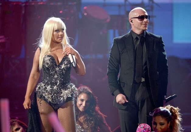 (L-R) Singer Christina Aguilera and rapper Pitbull perform onstage during the 40th American Music Awards held at Nokia Theatre L.A. Live on November 18, 2012 in Los Angeles, California.  (Photo by Kevin Winter/Getty Images) Photo: Kevin Winter, Getty Images / 2012 Getty Images