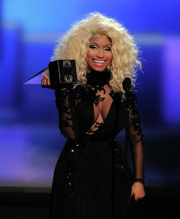 Recording artist Nicki Minaj accepts the award for Favorite Rap/Hip-Hop Artist onstage during the 40th American Music Awards held at Nokia Theatre L.A. Live on November 18, 2012 in Los Angeles, California.  (Photo by Kevin Winter/Getty Images) Photo: Kevin Winter, Getty Images / 2012 Getty Images