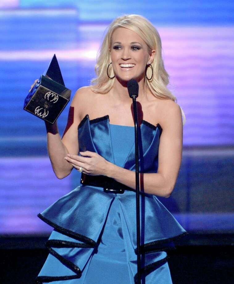 Singer Carrie Underwood accepts the award for Favorite Country Music Album onstage during the 40th American Music Awards held at Nokia Theatre L.A. Live on November 18, 2012 in Los Angeles, California.  (Photo by Kevin Winter/Getty Images) Photo: Kevin Winter, Getty Images / 2012 Getty Images