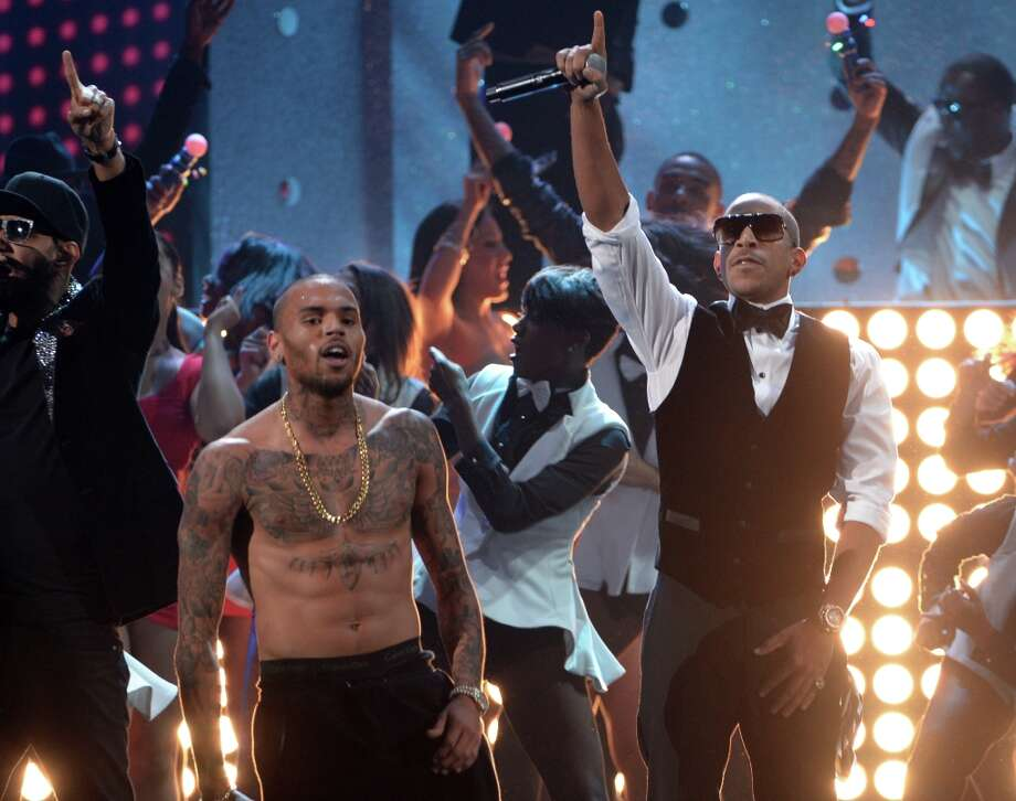 Singer Chris Brown (L) and rapper Ludacris perform onstage during the 40th American Music Awards held at Nokia Theatre L.A. Live on November 18, 2012 in Los Angeles, California.  (Photo by Kevin Winter/Getty Images) Photo: Kevin Winter, Getty Images / 2012 Getty Images