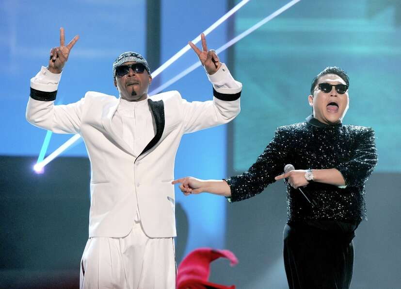 (L-R) MC Hammer and singer PSY perform onstage during the 40th American Music Awards held at Nokia T